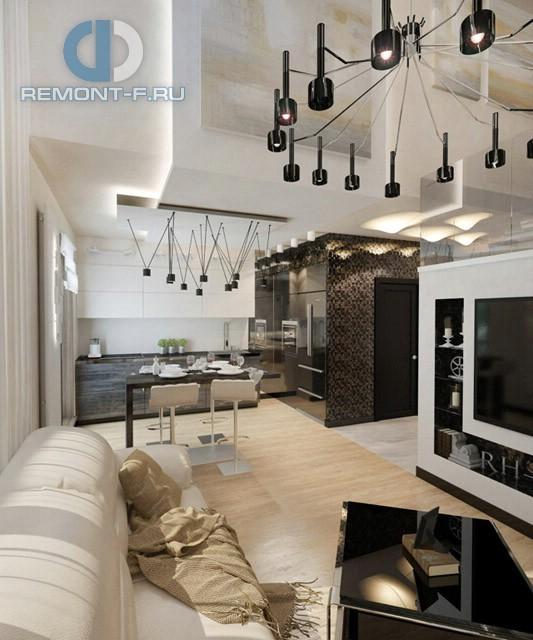 Дизайн кухни-гостиной в двухуровневой квартире в современном стиле. Фото интерьера