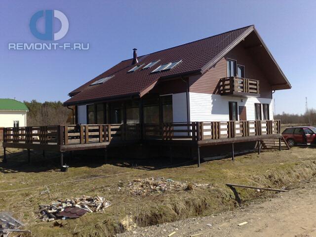 Красивый каркасный дом с террасой. Фото снаружи
