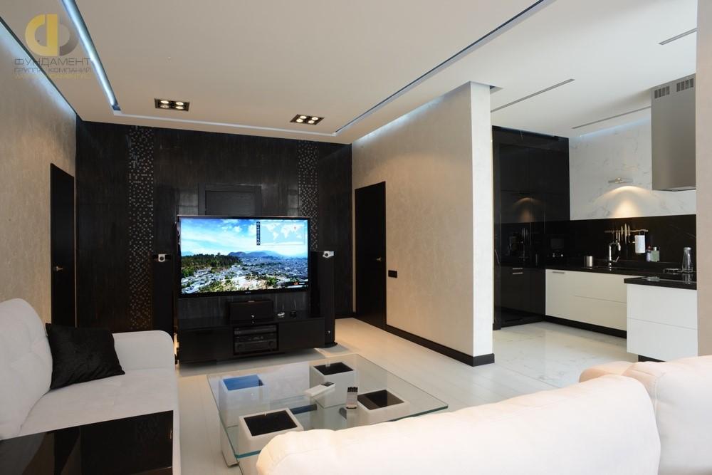 Интерьер гостиной с оригинальной ТВ-зоной