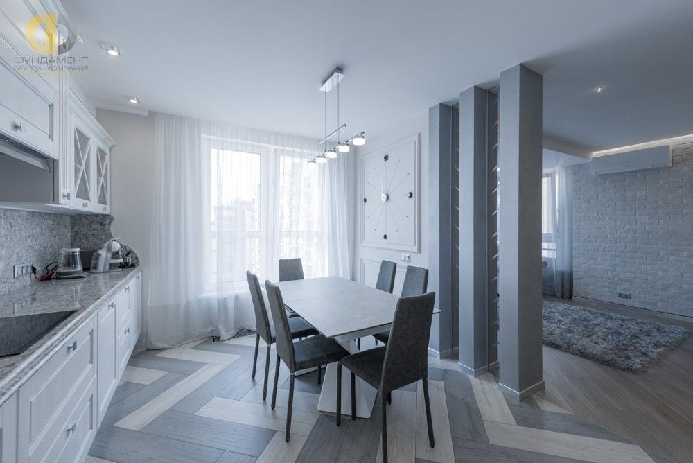 Интерьер кухни-столовой в серых тонах в современном стиле. Фото 2018