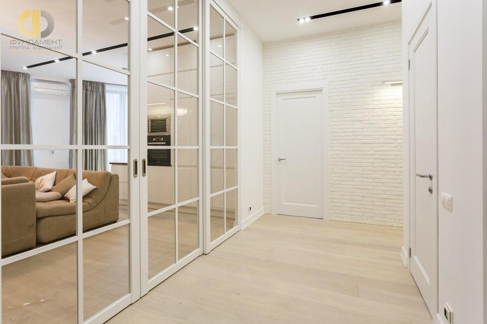 Интерьер квартиры в скандинавском стиле с раздвижной перегородкой – ЖК «Грюнвальд» Сколково